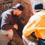 Two tradesmen crouching